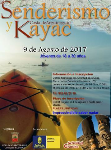 Cartel de senderismo y kayac en Arguineguín